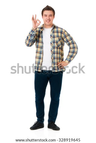 Successful young student boy showing ok sign, isolated on white background
