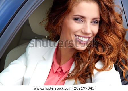 successful young woman in the car