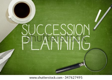 Succession planning concept on blackboard with pen - stock photo
