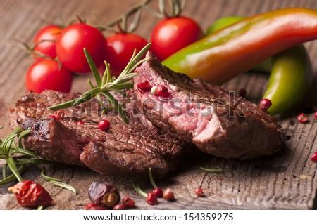 Succulent fillet steak and roast vegetables - stock photo