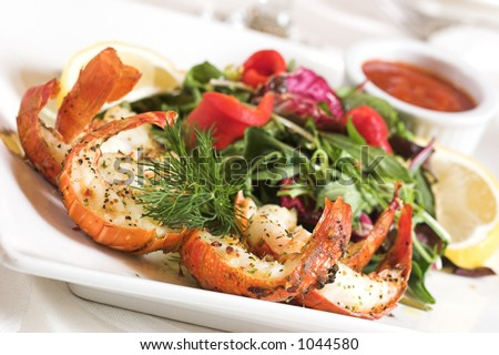 Succulent pieces of shrimp flavoured with herbs, served with fresh greens and dipping sauce.