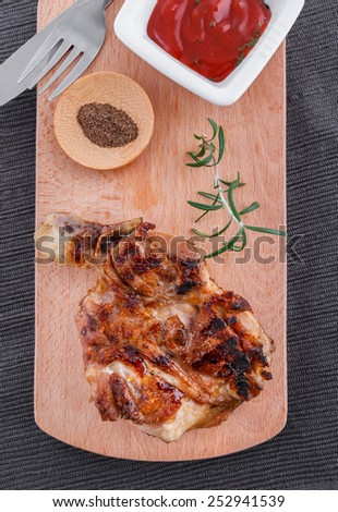Succulent thick juicy portions of grilled fillet steak served with tomatoes dip on an wooden board - stock photo
