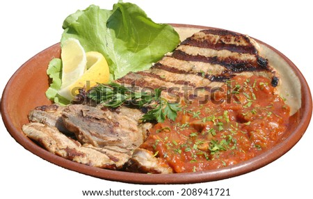 Succulent thick juicy portions of grilled steak served with tomato sauce and roast vegetables on an traditional plate