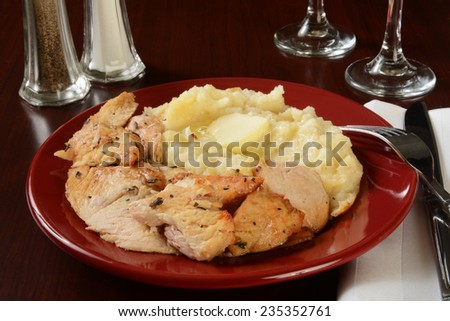 Succulent turkey with mashed potatoes and melted butter - stock photo