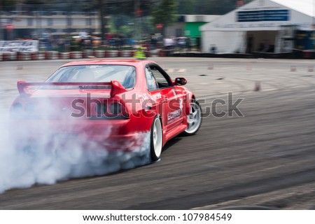 SUCEAVA, ROMANIA - MAY 26:Unknown driver performs a drifting demonstration at Third stage of the National Drift Championship, Toyota Suceava Drift Series ,May 26, 2012, Suceava, Romania - stock photo