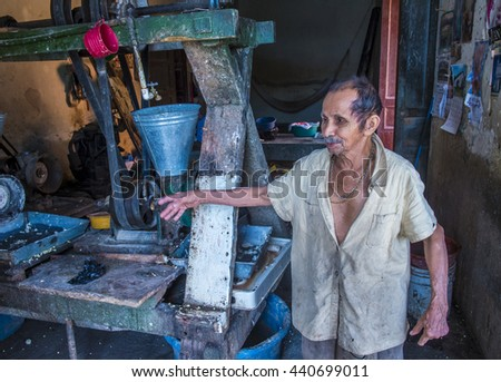 SUCHITOTO , EL SALVADOR  - MAY 07 : Salvadoran man work at a Corn tortilla factory in Suchitoto El Salvador on May 07 2016. Corn has been a staple food in Central American since pre-Columbian times