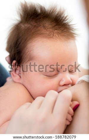 suckling infant baby girl - stock photo