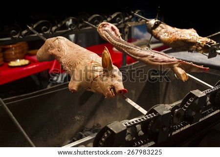 suckling pig on the barbecue - stock photo