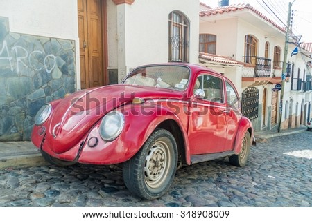 SUCRE, BOLIVIA - APRIL 21, 2015: Classic Volkswagen Beetle parked in a center of Sucre, Bolivia - stock photo