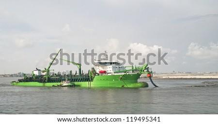 suction dredger - stock photo