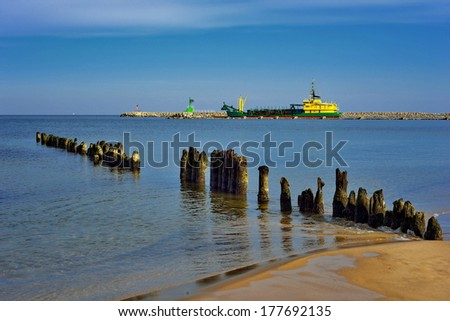 suction dredger,  deepening the port channel - stock photo