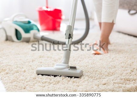 Suction grey carpet cleaning with vacuum cleaner - stock photo