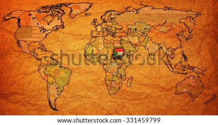 sudan flag on old vintage world map with national borders