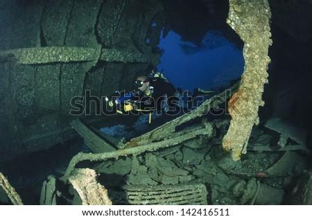 SUDAN, Red Sea, U.W. photo, Umbria wreck, a diver in the sunken ship - FILM SCAN - stock photo