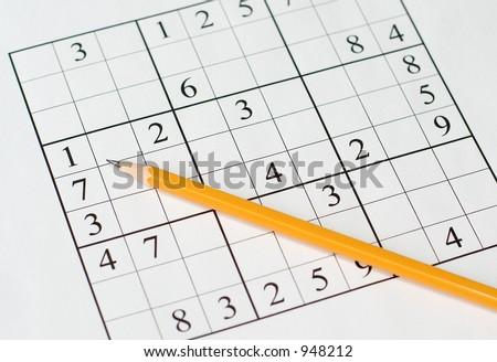 sudoku puzzle and yellow pencil - stock photo