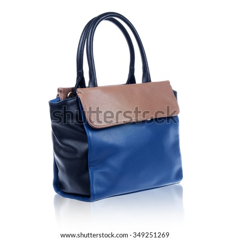 Suede blue and brown female bag on white background