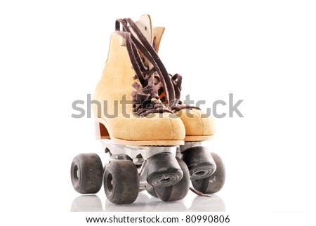 Suede Roller Skates with Brown Laces - stock photo