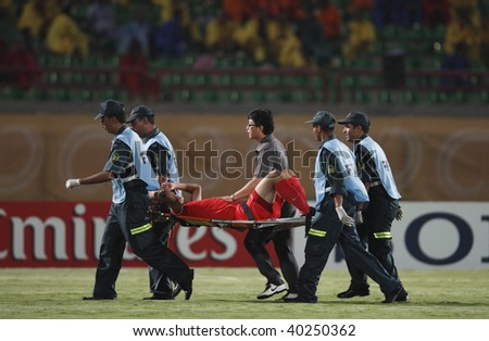 SUEZ, EGYPT - OCTOBER 9:  An injured South Korean player is stretchered off the pitch during a FIFA U-20 World Cup soccer match against Ghana October 9, 2009 in Suez, Egypt. - stock photo