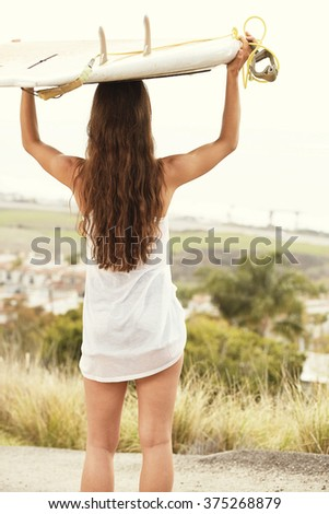 sufer girl with board - stock photo