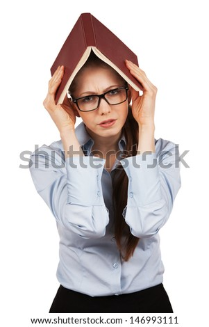Suffering girl holding a book over his head - stock photo