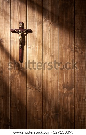 Suffering of Jesus Christ on the wooden wall. With shadows from a window frame. - stock photo