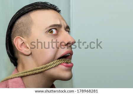 Suffering tied guy - stock photo