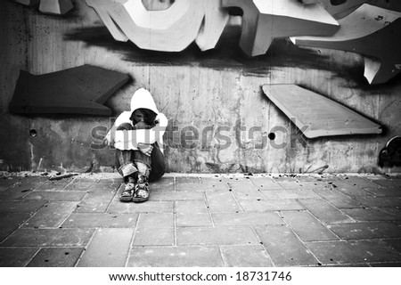 Suffering young girl on urban scenery.