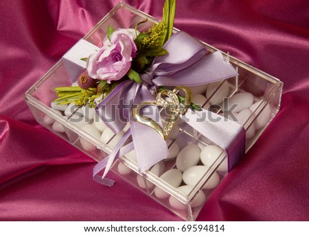 sugar almonds and flowers - stock photo