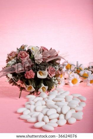 sugar almonds and flowers - weddings - stock photo