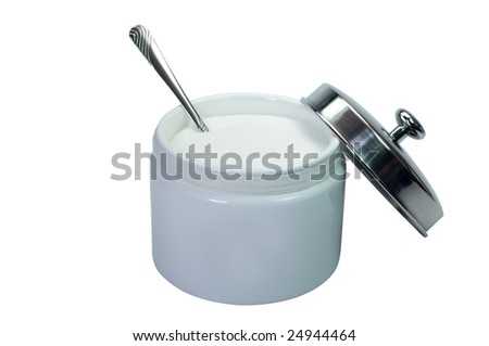 Sugar and spoon in bowl.  Isolated on white background with clipping path. - stock photo