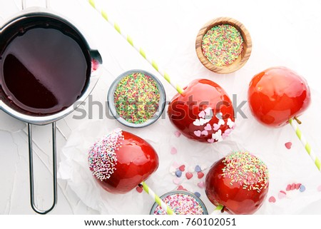Sugar apple with red icing. Sweets paradise apple from market in Germany. Sweet candy Apple