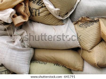 Sugar bags full sand - stock photo