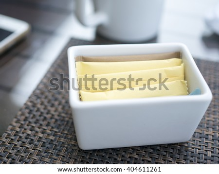 Sugar bags on table. - stock photo