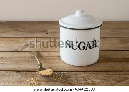 Sugar bowl on the wooden table