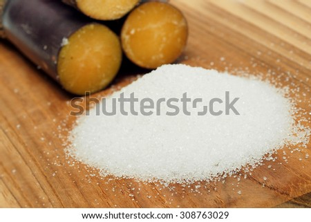 Sugar cane on wood background - stock photo