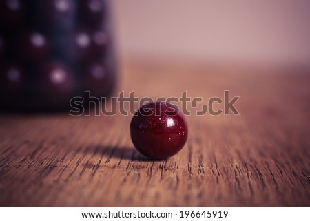 Sugar coated balls on a wooden table - stock photo