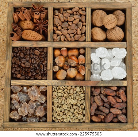 Sugar, coffee, and nuts in a wooden box - stock photo