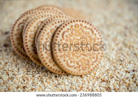 Sugar cookies on chopped nuts - stock photo