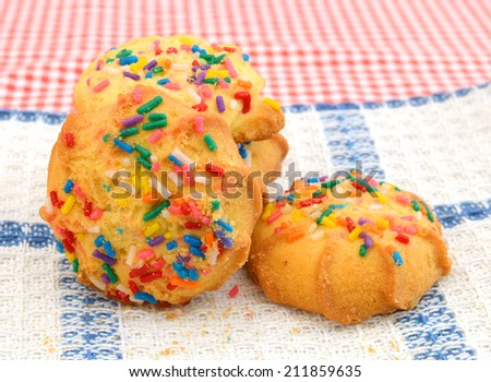 Sugar Cookies Over White Background on towel - stock photo