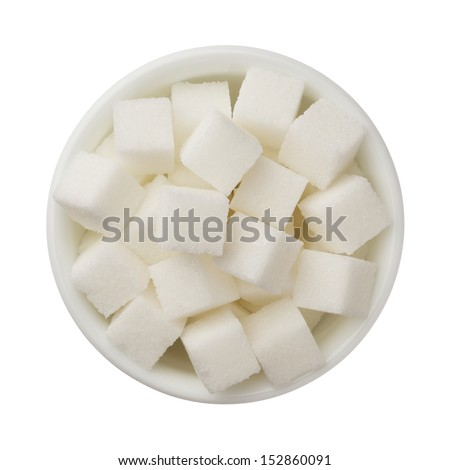 Sugar cubes in a bowl isolated on white background - stock photo