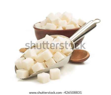 sugar cubes in scoop isolated on white background - stock photo