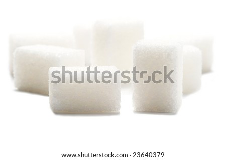 Sugar cubes isolated on a white background. Background blurred.