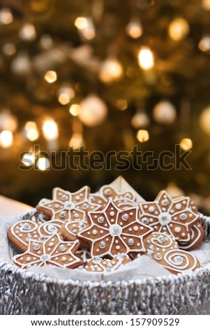 Sugar frosted cookies served on Christmas tree candle bokeh background - stock photo