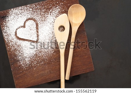sugar heart and spoon on wooden background - stock photo