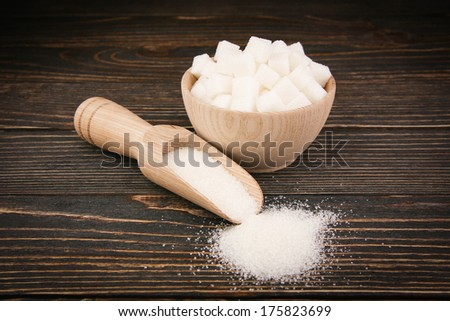 sugar in a wooden spoon - stock photo