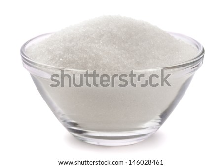 Sugar in glass bowl isolated on white - stock photo