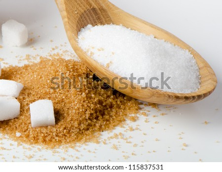 Sugar in wooden spoon - stock photo