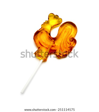 Sugar Lollipop in the Shape of Rooster Isolated on White Background - stock photo