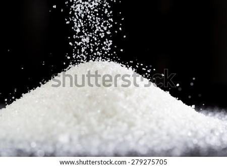 sugar on a black background - stock photo