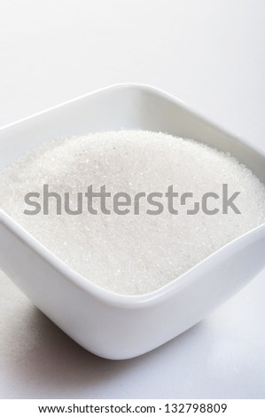 sugar on white background - stock photo